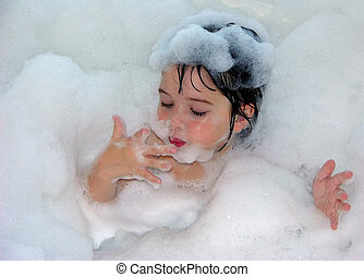 Bubble Spa Color - Little girl relaxing in a tub of bubbles