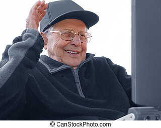 Aging happily - An old man enloying Internet