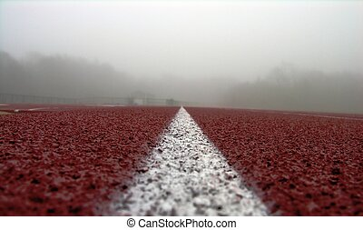 white line on red - running track at state university in ma...