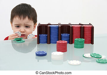 Boy Child Poker Chips - Small boy behind a stack of poker...