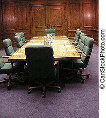 Meeting Room - Conference table and upholstered chairs in...