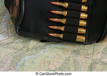 Ammo in pouch on map - 243 calibre hunting rifle ammunition...