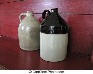 stoneware jugs on shelf