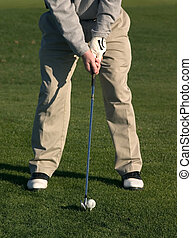 Golfer Chipping Ball - Golfer about to chip ball