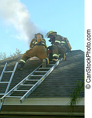 Smoke on roof - smoke coming from roof with firefighters on...