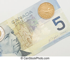 Canadian currency - A Canadian five dollar note and two...