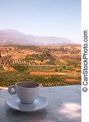 Coffee at Phaistos - A coffee cup on a table at a clifftop...