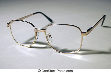 Isolated spectacles - A pair of glasses on a flat surface.