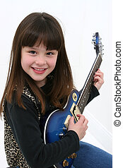 Electric Guitar Girl - Happy little girl playing a blue...