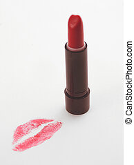 Lipstick kiss 2 - lipstick kiss on page with tube of...