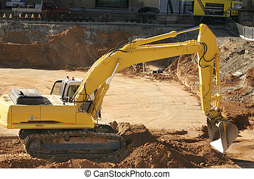 Earthmover - Woker operates the earthmover to make the...