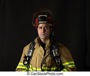Fire Fighter - Fire fighter with bunker wearing bunker gear...