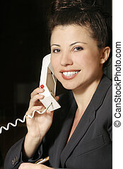 Business communictions - Businesswoman on phone
