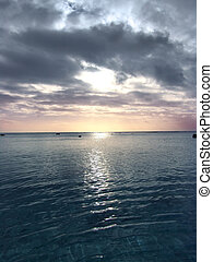 Still Water Sunset - sunset over water - Cook Islands