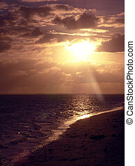 sun glistening on water - Rarotonga