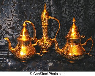 Brass Ware. - Brass Oriental vessels for tea or coffee on a...