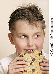 Monster cookie - Boy with a very large cookie A few crumbs...