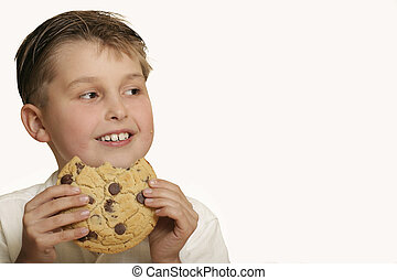 Boy with cookie - Boy with a choc chip cookie - space for...