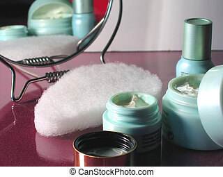 Skin Care - Skin care products reflected in mirror