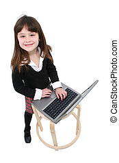 Child Using Laptop - School girl working on a laptop Shot...