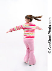 Child Spinning - Seven year old girl spinning Motion blur...
