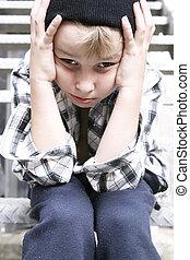 Street Kid - Depressed street kid sits on a fire escape...