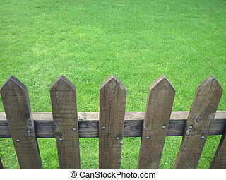 Fenced lawn - Wooden fenced fresh green lawn