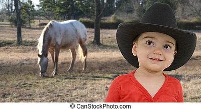 Cowboy Baby - Little cowboy in red long-johns and cowboy hat...
