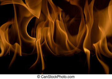A Roaring Fire - Close up view of a roaring fire in a...