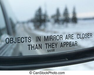 Objects in Mirror - Sideview mirror showing warning