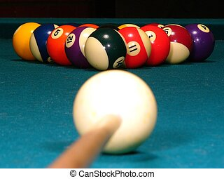Billiards - A billiard stick and cue ball get ready to break