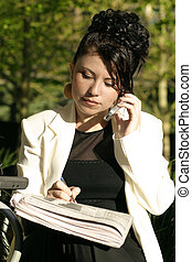 Woman at cafe doing business - A woman conducts business at...