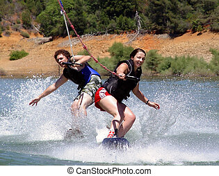 Couple wakeboarders - 2 wakeboarders behind the boat