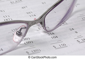 Accounting - Eyeglasses and Financial Document