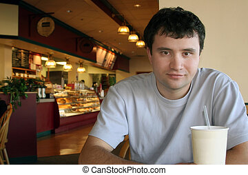 At a coffee shop - Man sitting in a coffee shop