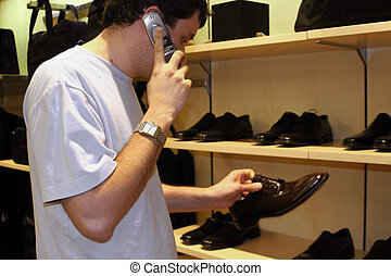 Business shopping - A man shopping for shoes