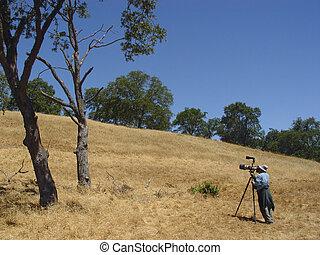 Birdwatcher taking pictures