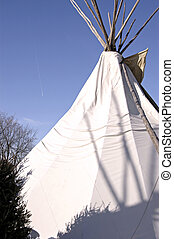 Teepee and Jet - Indian teepee with a jet flying overhead