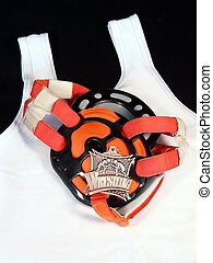 Wrestle - wrestling headgear and medal on a singlet