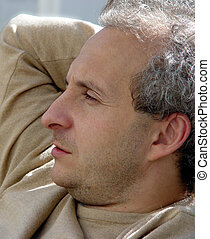 Contemplating - A middleage man with gray hair