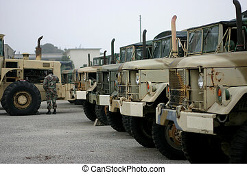 soldier and trucks