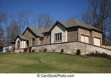 Rocky home - A lovely home with cultured stone used...