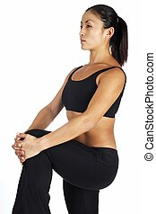 Hamstring Stretch - A female fitness instructor demonstrates...