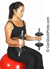 Seated Curl - A female fitness instructor demonstates a...