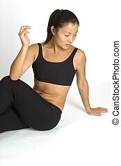 Hip Back Stretch - Fitness instructor demonstrates a lower...