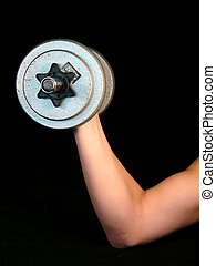 Weight-lifting - A dumbbell weight lited on a black...