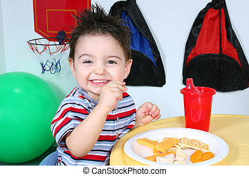 Boy Child Preschool - Two year old boy eathing cheese,...