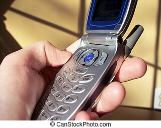 cell phone - holding a cell phone