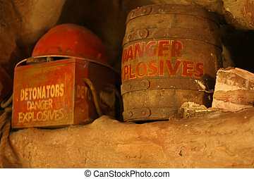Danger Explosives - Old explosives and mining helmut in a...