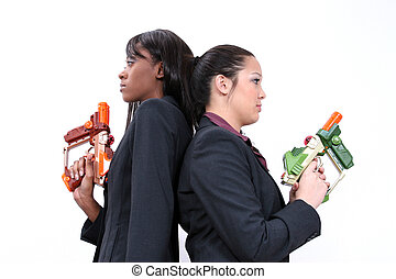Corporate Laser Tag - Two beatiful business women stand...